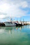 Fishing boat at harbor Stock Photos