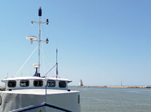 Fishing boat in harbor channel Stock Photos