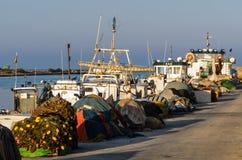 Fishing boat in harbor Stock Photo