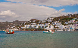 Fishing boat in harbor of Mykonos, the buildings Royalty Free Stock Photography