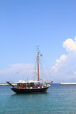 Fishing boat in the harbor of Mykonos island Stock Photo
