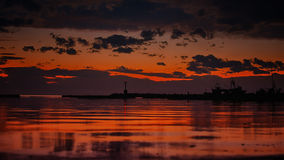 Fishing boat harbor at sunset. After the rain sunset skies overlooking the docks of a small fishing boat harbor Stock Images