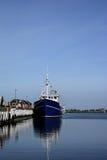 Fishing boat at the harbor stock photos