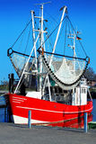 Fishing boat in the harbour Stock Photos