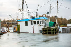 Fishing boat in harbour Stock Images