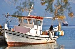 Fishing boat in the harbour of Fiskardo village, Kefalonia, Ionian islands, Greece. The last day of the summer season at Fiskardo in northern Kefalonia. Fishing Stock Photos