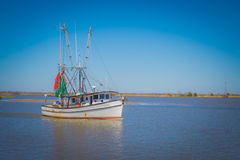 Fishing boat heading out in the gulf Stock Photography