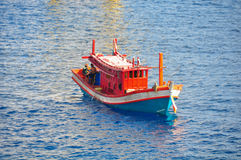 Fishing boat heading out to the gulf in the early morning. Stock Photos