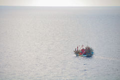 Fishing boat heading out to the gulf in the early morning. Fishing boat heading out to the gulf in the early morning Royalty Free Stock Photography