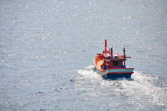 Fishing boat heading out to the gulf in the early morning. Stock Photography