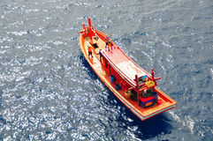 Fishing boat heading out to the gulf in the early morning. Royalty Free Stock Photo