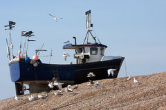 Fishing boat high up shingle bank Stock Images