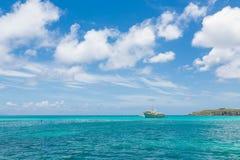 Fishing Boat on Horizon Stock Photography