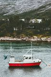 Fishing boat and house in forest island sea Landscape in Norway. Scandinavian Travel Royalty Free Stock Images