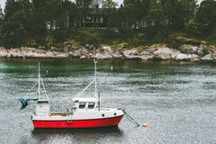 Fishing boat and house in forest island sea Landscape in Norway scandinavian. Travel Stock Images