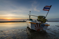 Fishing boat on the huahin beach, Thailand with sunrise. Fishing boat on the huahin beach in the morning, Thailand with sunrise Royalty Free Stock Images