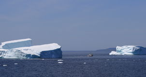 Fishing Boat Between Icebergs Royalty Free Stock Photography