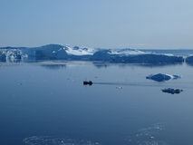 Fishing boat in Ilulissat Icefjord, Greenland. Royalty Free Stock Image