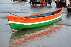 Fishing Boat in India. A background with a view of a fishing boat on an Indian coast, in the colors of the Indian flag Stock Images