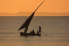Fishing boat - Inhassoro - Mozambique. Silhouette  of fishing boat at sunrise - Inhassoro - Mozambique Stock Photo