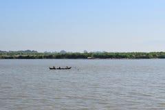 Fishing boat in Irawadi river, Myanmar. Buddha image in Bagan temple Royalty Free Stock Photography