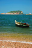Fishing boat with island Stock Images