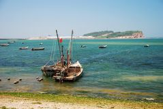 Fishing boat and island Royalty Free Stock Image