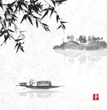 Fishing boat and island with trees in fog Royalty Free Stock Images
