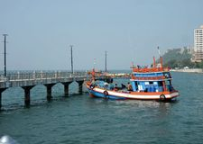 Fishing boat and the jetty in Angsila bay , Chonburi , Thailand Royalty Free Stock Photography