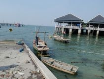 Fishing boat and the jetty in Angsila bay , Chonburi , Thailand Stock Photography