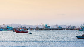 Fishing boat at jetty evening time stock video