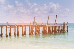 Fishing boat jetty over sea coast skyline Stock Photo