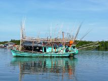 Fishing boat in Koh Kong. An amazing asian fishing boat in Koh Kong, an island in the Gulf of Thailand, in the coastal waters of Cambodia Royalty Free Stock Image