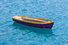 Fishing boat on a lake. A small fishing boat anchored in the middle of the lake on a beautiful sunny day stock image