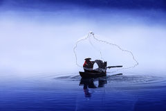 Fishing boat on the lake Stock Images