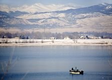 Fishing boat on a lake in winter Royalty Free Stock Image