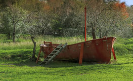 Fishing boat. On land in field Stock Photography