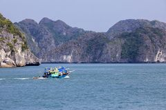 Fishing boat in Lanh Ha Bay. Fishermen live on the waters of Lanh Ha bay with its limestone karsts often covered with lush green vegetation royalty free stock photo
