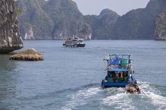Fishing boat in Lanh Ha Bay. Fishermen live on the waters of Lanh Ha bay with its limestone karsts often covered with lush green vegetation stock image