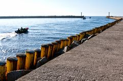 Fishing boat leaving Darlowo port Royalty Free Stock Images