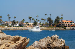 Fishing Boat leaving Harbor. A deep sea fishing boat in channel leaving the harbor Royalty Free Stock Photography