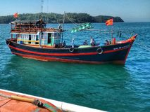Fishing boat leaving harbor of Quang Ngai, Vietnam Royalty Free Stock Photo