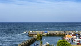 Fishing boat leaving the harbour boat stock photography