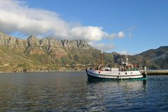 Fishing boat leaving Hout Bay Royalty Free Stock Photo