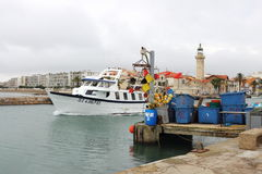 A fishing boat is leaving Le Grau-du-Roi harbour, France Stock Photo