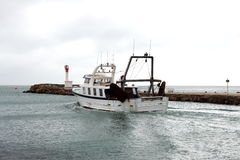 Fishing boat is leaving Le Grau-du-Roi harbour, France Stock Photo