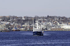 Fishing boat leaving New Bedford Stock Photo