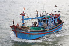 Fishing boat leaving Nha Trang Harbour Royalty Free Stock Photo