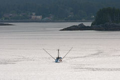 Fishing Boat Leaving Sitka. A fishing boat leaves Sitka, Alaska entering Crescent Bay Stock Image
