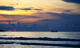 A fishing boat lies at sunset. A small fishing boat lies at sunset at Huahin, Thailand Royalty Free Stock Images